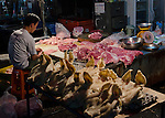 Pig heads for sale early in the morning at the local market
