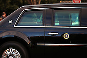United States President Barack Obama looks through a limousine window as the presidential inaugural parade winds through the nation's capital January 21, 2013 in Washington, DC. Barack Obama was re-elected for a second term as President of the United States. .Credit: Chip Somodevilla / Pool via CNP