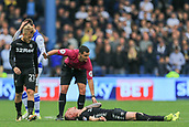 1st October 2017, Hillsborough, Sheffield, England; EFL Championship football, Sheffield Wednesday versus Leeds United; Referee Andrew Madley calls for help from the bench as Pontus Jansson of Leeds United FC is knocked unconscious