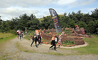 Pictured: People by the mythical beast sculpture by artist Gwen Heeney Saturday 13 August 2016<br />Re: Grow Wild event at  Furnace to Flowers site in Ebbw Vale, Wales, UK