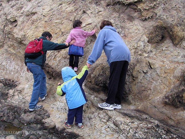 Agate Beach CA Father, mother and children three and five exploring beach cliffs together while on vacation MR