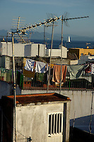 Crooked TV Aerials on rooftops of buildings, Tarifa, Andalusia, Spain.