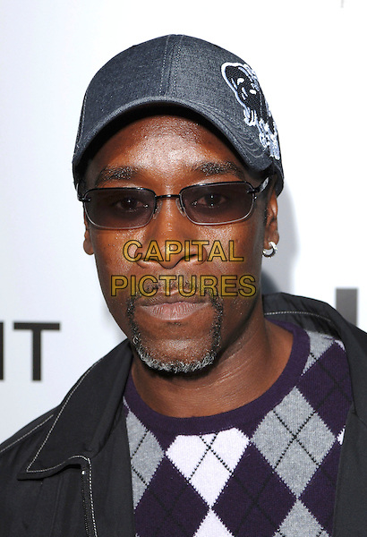 "DON CHEADLE.World premiere of the film ""Crash"".Held at the Samuel Goldwyn Theatre in Beverly Hills, California, USA, 26th April 2005. .portrait headshot glasses beard  cap hat sunglasses.Ref: MOO.www.capitalpictures.com.sales@capitalpictures.com.©Capital Pictures"
