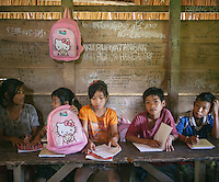 Mentawai children studying in the jungle school at the village of Buttui. The Mentawai are the tribes living traditionally in the island of Siberut, Indonesia. Here, where the changes came slow, some of the people are still living like their ancestors did centuries ago. They s till practice ancient religion called Arat Sabulungan, which believe that everything in the forest has a spirit.