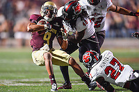 Texas State wide receiver C.J. Best (9) is brought down by Arkansas State linebacker Qushaun Lee (48) during NCAA Football game, Thursday, November 20, 2014 in San Marcos, Tex. Texas State leads Arkansas State 28-14 at the halftime. (Mo Khursheed/TFV Media via AP Images)