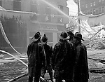 Pittsburgh PA:  City firemen fighting the Jackson Building fire in downtown - 1948