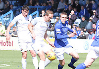 Iain Wilson pressuring Paul Watson in the SPFL Ladbrokes Championship Play Off semi final match between Queen of the South and Montrose at Palmerston Park, Dumfries on  11.5.19.