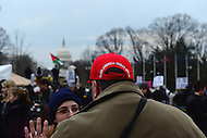 Washington, DC - January 20, 2017: A Donald Trump supporter speaks with a woman who opposes Trump blocks from the U.S. Capitol before the inauguration of Donald J. Trump as the 45th President of the United States, January 20, 2017.  (Photo by Don Baxter/Media Images International)