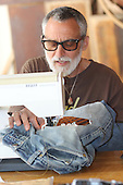 People spent Saturday afternoon learning to stitch, patch and sew old garments to make them new again.<br /> <br /> Doug Shaeffer learned how to apply decorative patches to an old pair of jeans.