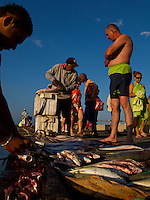 A tourist from Bogota scopes the daily catch at a beach pier in Santa Marta. - Santa Marta - Colombia