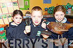 BOGGED DOWN: Lyreacrompane National School pupils Caoinhe Nolan and Padraig O'Donoghue enjoying a Bog Day in Lyre on Friday last where they hosted pupils from Derrinagree National School in Dromtarrif. Pictured with the Lyre students is Sara Ceowley from Derrinagree NS.   Copyright Kerry's Eye 2008