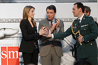Princess Letizia of Spain attends the 'El Barco de Vapor' literature awards is assisted by one of his assistants in presence of the President of the Madrid Region Jose Ignacio Gonzalez.April 9, 2013.(ALTERPHOTOS/Acero) /NortePhoto