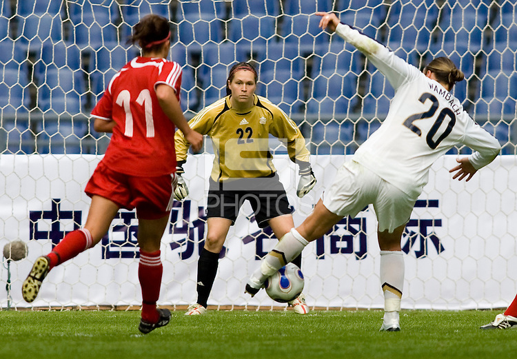 Abby Wambach of the USA shoots at Canada goalkeeper Erin McLeod. The U.S. defeated Canada, 4-0, during the Four Nations Tournament in Guangzhou, China on January 16, 2008.