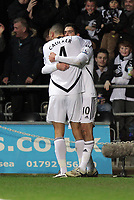 Pictured: Danny Graham (R) of Swansea celebrating his goal with teammate Steven Caulker. Tuesday 27 December 2011<br /> Re: Premier League football Swansea City FC v Queens Park Rangers at the Liberty Stadium, south Wales.