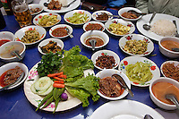 Myanmar, Burma, Kalaw.  Curry lunch of pork, cucumbers, beans, soup, spicy sauce, vegetables.