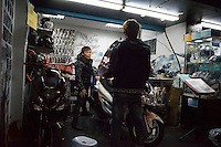 "Taiwanese youths check out a motorbike at a workshop in Ximending District, Taipei, Taiwan, 2015. Ximending has been a famous area for shopping and entertainment since the 1930s. Historic structures include a concert hall, a historic cinema, and the Red House Theatre. Modern structures house karaoke businesses, art film cinemas, wide-release movie cinemas, electronic stores, and a wide variety of restaurants and fashion clothing stores. The pedestrian area is especially popular with teens and has been called the ""Harajuku"" of Taipei."