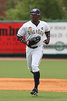 DeAngelo Mack #11 of the Charleston RiverDogs running in from the outfield during a game against the Rome Braves on April 27, 2010 in Charleston, SC.