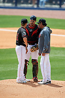 Nashville Sounds pitching coach Rick Rodriguez (27) talks with his players on the mound during a game against the New Orleans Baby Cakes on May 1, 2017 at First Tennessee Park in Nashville, Tennessee.  Nashville defeated New Orleans 6-4.  (Mike Janes/Four Seam Images)