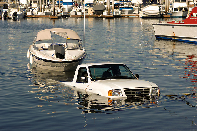 Truck and boat in water at launch ramp