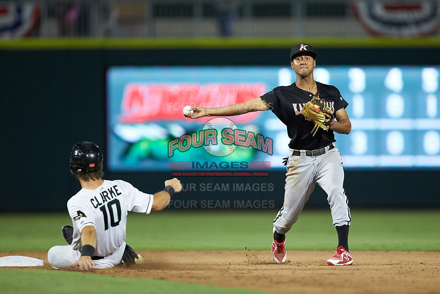 Kannapolis Intimidators shortstop Lenyn Sosa (2) makes a throw to first base as Zander Clarke (10) of the Augusta GreenJackets slides into second base at SRG Park on July 6, 2019 in North Augusta, South Carolina. The Intimidators defeated the GreenJackets 9-5. (Brian Westerholt/Four Seam Images)