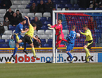 Ross Draper (furthest left) heads the equalising goal past a diving Chris Dilo in the Inverness Caledonian Thistle v St Mirren Scottish Professional Football League Premiership match played at the Tulloch Caledonian Stadium, Inverness on 29.3.14.