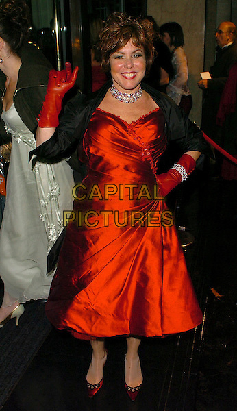RUBY WAX.The Orange British Academy Film Awards aftershow & Grosvenor House Hotel, London, UK..February 19th, 2006.Ref: CAN.full length red silk satin dress gloves hand on hip waving black.www.capitalpictures.com.sales@capitalpictures.com.© Capital Pictures.