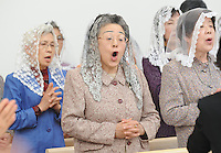 The choir sing during Cardinal Robert Sarah, President of the Pontifical Council COR ANUM's presence, at the Cathedral of St Peter and St Paul, Sendai, Miyagi Prefecture,  Japan.  the Cardinal was touring the Tsunami hit areas around Sendai, Japan.<br />