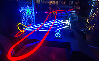 NWA Democrat-Gazette/BEN GOFF @NWABENGOFF<br /> A neon piece made by Greg Brown sits in the front window Thursday, Nov. 8, 2018, at Rogers Experimental House during the 'Light Up the Night!' one year anniversary Art on the Bricks art walk in downtown Rogers. More than 25 artists and musicians opened pop-up galleries selling their artwork at downtown shops and restaurants. Go Downtown Rogers hosts the walks on the second Thursday of each month.