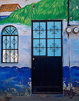 Nayarit, Mexico<br /> Doorway and painted wall on a side streen in the village of Bucerias