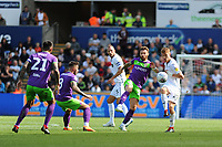 Andreas Weimann of Bristol City vies for possession with Jay Fulton of Swansea City during the Sky Bet Championship match between Swansea City and Bristol City at the Liberty Stadium, Swansea, Wales, UK. Saturday 25 August 2018