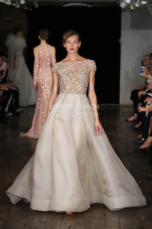 """Model walks runway in a """"Boyfriend"""" bridal gown from the Rivini by Rita Vinieris Fall 2017 collection on October 7th, 2016 during New York Bridal Fashion Week."""