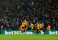27th December 2019; Molineux Stadium, Wolverhampton, West Midlands, England; English Premier League, Wolverhampton Wanderers versus Manchester City; Matt Doherty of Wolverhampton Wanderers jumps in the air to celebrate taking the lead 3-2 in the 89th minutes of the match - Strictly Editorial Use Only. No use with unauthorized audio, video, data, fixture lists, club/league logos or 'live' services. Online in-match use limited to 120 images, no video emulation. No use in betting, games or single club/league/player publications - Strictly Editorial Use Only.