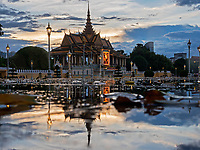Storm approaching over the Grand Performance Hall at the Grand Palace in Phnom Penh, Cambodia. Reflection of the Grand Palace during a tropical rain shower in Phnom Penh, Cambodia