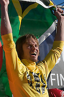 "Grant ""Twiggy"" Baker holds up a South African flag on stage during the awards ceremony at the 2008 Mavericks Surf Contest in Half Moon Bay, Calif., Saturday, January 12, 2008...Photo by David Calvert/isiphotos.com"