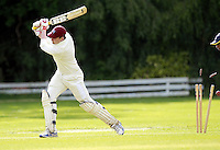 Ed Atkins of Highgate is bowled by Mehul Gokhani during the ECB Middlesex Division Three game between Highgate and Harrow Town at Park Road, Crouch End on Saturday May 24, 2014