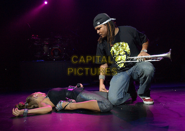 THE BLACK EYED PEAS.Live during The Honda Civic Tour held at Universal Ampitheatre in Universal City, California, USA.  .March 28th, 2006.Ref: DVS.stage concert gig music band performance laying lying on floor trumpet full length.www.capitalpictures.com.sales@capitalpictures.com.Supplied By Capital PIctures