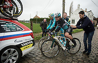after having crashed on the slippery cobbles, Mark Cavendish (GBR/Ettix-QuickStep) is helped back on his bike to continue racing<br /> <br /> 77th Gent-Wevelgem 2015