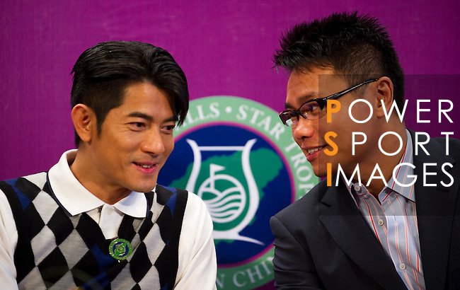 HAIKOU, CHINA - OCTOBER 28:  Hong Kong singer and film actor Aaron Kwok (L) talk with Dr. Ken Chu, Vice Chairman of Mission Hills Group during a press conference as part of the Mission Hills Star Trophy on October 28, 2010 in Haikou, China. The Mission Hills Star Trophy is Asia's leading leisure liflestyle event and features Hollywood celebrities and international golf stars. Photo by Victor Fraile / The Power of Sport Images