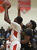 Myles Goddard #24 of Amityville, left, looks to drives to the net as Jadan McNaughton #12 of Wyandanch defends during Suffolk County League VI varsity boys basketball game at Amityville High School on Tuesday, Jan. 2, 2018. Amityville won by a score of 95-50.