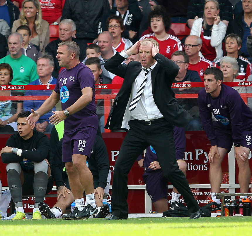 Derby County's Head Coach Steve McClaren  sees Jake Buxton sent off<br /> <br /> Photographer Mick Walker/CameraSport<br /> <br /> Football - The Football League Sky Bet Championship - Nottingham Forest v Derby County - Sunday 14th September 2014 - The City Ground - Nottingham<br /> <br /> &copy; CameraSport - 43 Linden Ave. Countesthorpe. Leicester. England. LE8 5PG - Tel: +44 (0) 116 277 4147 - admin@camerasport.com - www.camerasport.com
