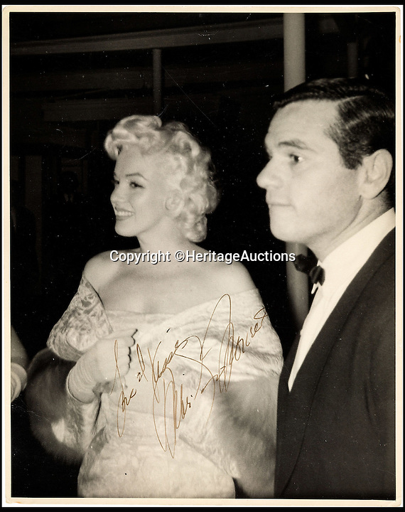 BNPS.co.uk (01202 558833)<br /> Pic: HeritageAuctions/BNPS<br /> <br /> Signed photo of Marilyn Monroe, from 1955, standing next to her business partner Milton Greene.<br /> <br /> A trove of rare and never-seen-before snapshots of Hollywood legend Marilyn Monroe have emerged for sale from the collection of a superfan who spent years following the star.<br /> <br /> The collection of 183 pictures of the pin up were all taken around New York in the mid-1950s by superfan James Collins, a teenager who was a member of the 'Monroe 6'.<br /> <br /> The youngsters were such avid fans Monroe ended up knowing them all by name and allowed them special access to her to take countless photos and signed numerous autographs.<br /> <br /> Collins is now auctioning the 183 photos in 18 lots through Heritage Auctions in Dallas, Texas.