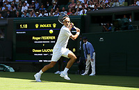 Roger Federer (SUI) in action against Dusan Lajovic (SRB) during their first round match<br /> <br /> Photographer Rob Newell/CameraSport<br /> <br /> Wimbledon Lawn Tennis Championships - Day 1 - Monday 2nd July 2018 -  All England Lawn Tennis and Croquet Club - Wimbledon - London - England<br /> <br /> World Copyright &not;&copy; 2017 CameraSport. All rights reserved. 43 Linden Ave. Countesthorpe. Leicester. England. LE8 5PG - Tel: +44 (0) 116 277 4147 - admin@camerasport.com - www.camerasport.com