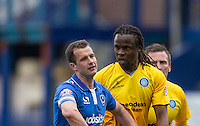 Marcus Bean of Wycombe Wanderers has words with Michael Doyle of Portsmouth during the Sky Bet League 2 match between Portsmouth and Wycombe Wanderers at Fratton Park, Portsmouth, England on 23 April 2016. Photo by Andy Rowland.