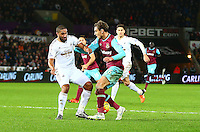 Ashley Williams of Swansea City tackles Nikica Jelavic of West Ham United when through on goal during the Barclays Premier League match between Swansea City and West Ham United played at The Liberty Stadium, Swansea on 20th December 2015