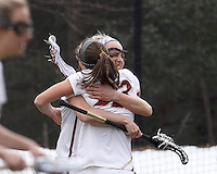 Boston College midfielder Cali Ceglarski (23) celebrates her goal with Boston College midfielder Mikaela Rix (17).  Syracuse University (orange) defeated Boston College (white), 17-12, on the Newton Campus Lacrosse Field at Boston College, on March 27, 2013.