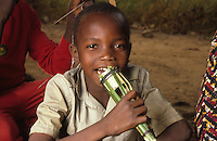 Young boy playing with self-made microphone