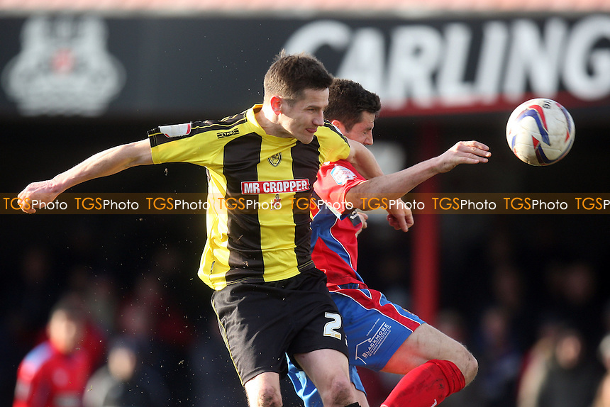 Ben Strevens of Dagenham and Billy Kee of Burton Albion - Dagenham and Redbridge vs Burton Albion at the London Borough of Barking and Dagenham Stadium - 16/03/13 - MANDATORY CREDIT: Dave Simpson/TGSPHOTO - Self billing applies where appropriate - 0845 094 6026 - contact@tgsphoto.co.uk - NO UNPAID USE.