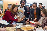 People get Lunar New Year treats from various Asian countries to try at a Lunar New Year celebration at Middlesex Community College's Asian American Connections Center on Thurs., Feb. 15, 2018. The Asian American Connections Center was established at the school using a federal grant in 2016 and serves as a focal point for the Asian community at the school, predominantly Cambodian, to gather, socialize, study, and otherwise take part in student life. Bopha Malone, a Trustee of the College, (left in red), Cherry Lim, Specialist for Asian American Student Advancement Program (center in orange dress with gray top), and Pam Flaherty, Dean of Students and Senior Student Affairs Officer (seated at right), joined in the celebration.