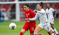 CARSON, CA - FEBRUARY 9: International Veterans Christine Sinclair #12 of Canada and Ali Krieger #11 of the USA battle for a ball during a game between Canada and USWNT at Dignity Health Sports Park on February 9, 2020 in Carson, California.
