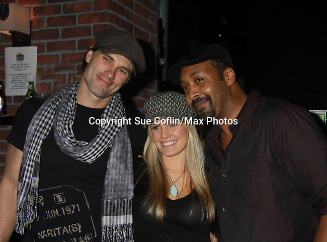 One Life To Live Terri Conn and Austin Peck and Jesse L. Martin - Stars of Daytime and Prime Time Television and Broadway bartend to benefit Stockings with Care 2011 Holiday Drive  - Celebrity Bartending Event with Silent Auction & Raffle on November 16, 2011 at the Hudson Station Bar & Grill, New York City, New York. For more information - www.stockingswithcare.org.  (Photo by Sue Coflin/Max Photos)